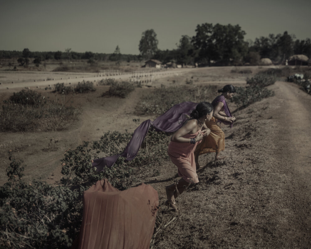 poulomi basu centralia women running with weapons